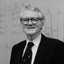 8/11/1983 David M. Mason, professor of chemical engineering, in front of white board.